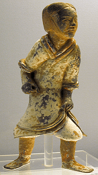 An Eastern-Han pottery soldier, with a now-faded coating of paint, is missing a weapon.